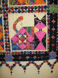 """close up, """"Love and Dream"""" cat quilt with yo yo sashing and embellishment; cathedral windows border. Spotted at the 2007 Tokyo International Quilt Festival.  Photo by Oregon quilt."""