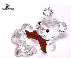 "Swarovski Clear Crystal Figurine RECLINING KRIS BEAR w/ Artist Signature #7637NR000001 Size: 2"" tall x 1"" wide New in original box"