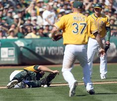 Oakland Athletics catcher George Kottaras makes an error on a pop-up by Texas Rangers' Mike Napoli during the third inning of their game against the Texas Rangers at O.co Coliseum in Oakland, Calif. on Wednesday, Oct. 3, 2012. (Jane Tyska/Bay Area News Group)