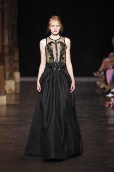 Floor length black gown with Tulle bodice and detailing