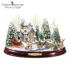 Master Artisan-designed hand-painted sculpture inspired by the beloved art of Thomas Kinkade with illumination and music.