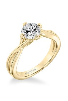 """Brides.com: . Style 31-V677ERY, """"Kennedy"""" Contemporary diamond solitaire split shank engagement ring, $685 (14K yellow gold setting only), ArtCarved"""