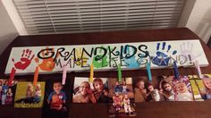 """""""Grandkids make life grand!"""" sign with clothespins attached to hang pictures."""