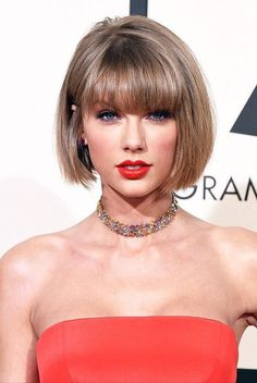 Of course, Taylor Swift's best hairstyle. A straight bob cut with full bangs. The cut highlights one of her best features, her face!