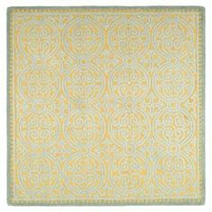 Hand-tufted wool rug in blue and gold with a medallion motif.  Product: RugConstruction Material: WoolColor: Blue and goldFeatures: Hand-tuftedDimensions: 6' x 6'Note: Please be aware that actual colors may vary from those shown on your screen. Accent rugs may also not show the entire pattern that the corresponding area rugs have.