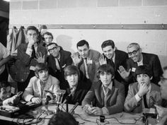 At a Melbourne press conference along with their temporary stand-in drummer Jimmy Nicol at the Southern Cross Hotel, 1964.
