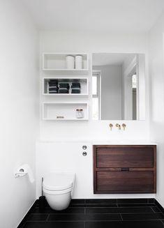 small bathroom solutions Storage shelves above toilet, ledge above toilet, large draws, gold plumbing, add storage behind mirror - YES! Bathroom Toilets, Laundry In Bathroom, Bathroom Shelves, Small Bathroom, Light Bathroom, Guest Bathrooms, Bathroom Layout, Interior Design Minimalist, Minimalist Decor