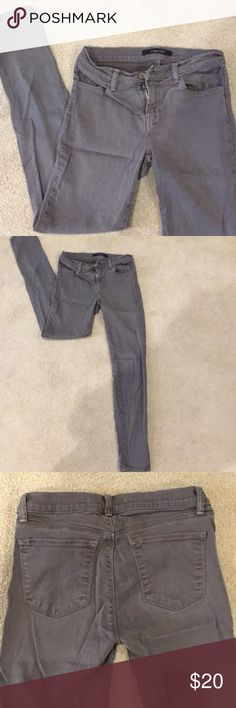 """J Brand Skinny Jeans J Brand size 28 super skinny Spruce jean. Olive/grey wash color.  Rise measures 8"""", inseam 28"""".  I typically wear a 27 in other jeans and these fit so I would say they run slightly small.  Material is 70% tencel 28% cotton 2% elastane.  No holes, stains or damage, just been sitting in my closet for awhile. J Brand Jeans Skinny"""