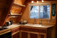 Here's a simple and relatively tiny A-frame cabin in the woods. Description from tinyhousetalk.com. I searched for this on bing.com/images