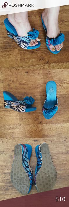 """Blue Floral Ruffle Wedge Heels Worn once. Still in great comdition. As you can see in the photo, there is residue from the price tag on the insole of the left shoe. Blue faux suede with floral print amd a blue ruffle. Size 8. Fits true to size. 4.5"""" heel. Bolaro Shoes Wedges"""