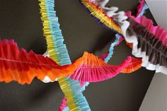 """Best tutorial!! Used this tonight to make some for Sam's 3rd birthday party. I used a chopstick as a """"dowel"""" to hold my crepe paper & did have to create a little extra tension by holding the thread on top with my fingers. The thread was a little heavier (all I had on hand) If I had used a light weight thread I wouldn't have needed to.  {TUTORIAL: Ruffled Streamers   MADE}"""