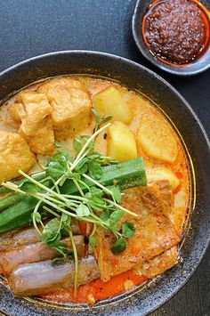 3 dishes : ORGANIC SOYA MILK CURRY LAKSA NOODLES, Asam laksa, Nasi lemak (Chef Wan)