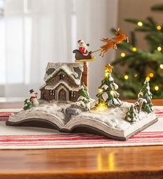 This lovely Lighted Santa Storybook Holiday Accent looks like an open pop-up book, but it's a resin sculpture perfect for holiday decorating. Christmas Cake Designs, Christmas Projects, Christmas Home, Holiday Crafts, Christmas Holidays, Christmas Decorations, Xmas, Christmas Ornaments, Holiday Decorating