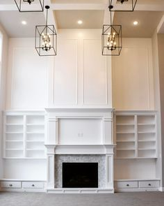 QUOTE to do the two-story millwork above the fireplace/built-ins. Two Story Fireplace, White Fireplace, Fireplace Wall, Fireplace Surrounds, Fireplace Design, Fireplace Ideas, Built In Around Fireplace, Fireplace Built Ins, Fireplace Remodel
