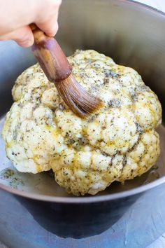 Whole Roasted Cauliflower gets coated in a delicious garlic and herb sauce for an impressive and easy healthy side dish recipe. This oven roasted cauliflower head recipe is gluten-free dairy-free vegan vegetarian low-carb keto and Paleo approved! Veggie Side Dishes, Healthy Side Dishes, Vegetable Dishes, Side Dish Recipes, Vegetable Recipes, Food Dishes, Keto Recipes, Vegetarian Recipes, Cooking Recipes