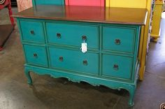 Tourquoise painted dresser with drown glaze or wax