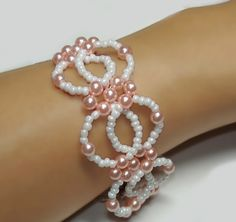 In this tutorial you'll learn how to make a spectacular bead-interlocking bracelet with pearls and seed beads. Beading is made easy with these step-by-step instructions and full color illustrations.  This bracelet design perfectly incorporates the rich sheen of pearls and the delicate vibes of elegance from seed beads, giving it an uncomplicated yet opulent effect.  You will receive the tutorial in PDF readable format. File size is about 200 KB.  Please do not distribute, sell or reproduce…