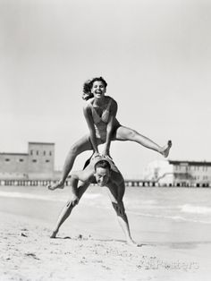 Stockfoto : Couple playing leapfrog on beach, woman jumping over man. Vintage Photography, Couple Photography, Friend Photography, Maternity Photography, Photography Poses, Photography Contract, Pinterest Photography, Photography Studios, Framing Photography