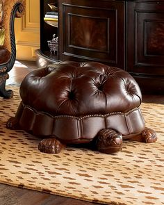This tortoise footstool from the Horchow Home Decorations Catalog is so cool, it makes me wish I had a library to put it in. Sadly, I keep my books in a box. [Tortoise Footstool] [Via: Neatorama] Funky Furniture, Unique Furniture, Furniture Design, Leather Ottoman, Tufted Ottoman, Tortoises, Sweet Home, House Design, Cool Ideas
