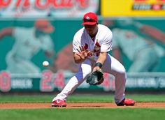 Jhonny Peralta fields a ground ball during the eighth inning against the Cincinnati Reds. cARDS LOST 4-0. 4-09-14