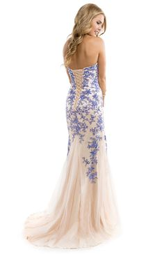 We love the contrasting lace appliques pieced over nude tulle on this trendy prom dress   by FLIRT #prom #eveningdress