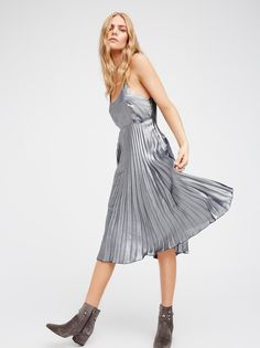 Mermaid Midi Dress | Eye-catching mermaid-inspired metallic midi dress with a pleated design. Straps feature a cute crossed detail in back. Hidden side zipper closure. Lined.