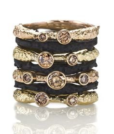 18k gold & black steel rings with chocolate diamonds by Sarah Graham