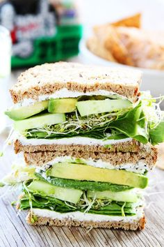 Green and yummy looking! Cucumber and Avocado Sandwich Recipe on twopeasandtheirpod.com This fresh and simple sandwich is made with cucumber, avocado, lettuce, sprouts, and herbed goat cheese.
