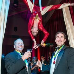 Such a fun shot of our aerial bartender serving champagne! aerial artists of Houston, aerial silks, J and D Entertainment, Houston Entertainment company www.jdentertain.com