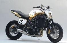 Triumph flat tracker Custom Street Triple. Cool job with the headlights. Not too keen on the paint.