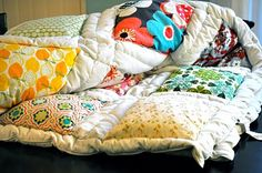what a fantastic idea! add quilt squares to the top of a down comforter -- i am SO doing this. beautiful quiltiness on the top layer--smooth wonderfulness of down comforter underneath!