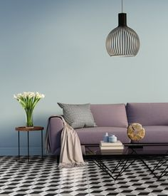 interior design: Blue elegant interior with purple sofa and flowers