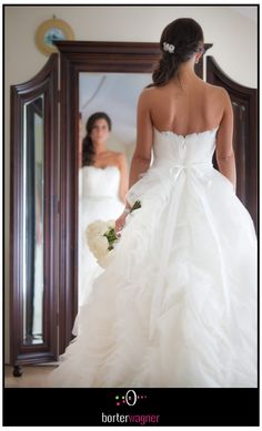 back of bride's wedding dress.  Photographed at Willow Harbor Vineyards.     borterwagner photography  borterwagner.com