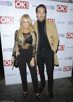 Handsome couple: Danielle Armstrong turns heads in a see-through blouse alongside boyfrien...