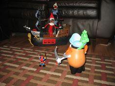 John Henry versus Pirate Mr. Potato Head.  Who will win on the high seas?  -KZB