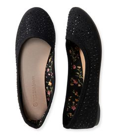 """Your footwork will def be fancy when you wear our Studded Flat! The fabulous shoe is fashioned with light-catching rhinestones that promise total glitz, while the rubber sole sports ribbed traction for excellent grip.<br><br>Height: 2.5""""<br>Style: 0151. Imported.<br><br>Fabric upper; rubber sole."""