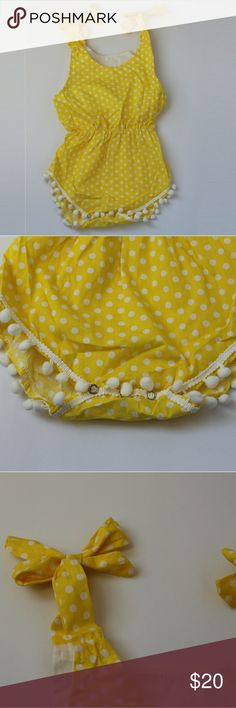 Yellow polka dot pom-pom romper Yellow polka dot romper. Ties at shoulders, snaps at bottom. Cute pom-pom edging.  Sizes: Small: 0-12 months Medium: 1-2 years Large: 3-4 years One Pieces