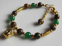 Religious Gold Buddha Green Jade Tiger Eye Bracelet. https://www.etsy.com/ca/listing/180684284/