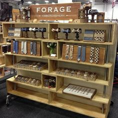 Wooden shelving unit instead of a craft fair table. Painting business name on a piece of wood for signage