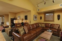 This is my favorite wall color and I'm glad to see how well that brown leather goes with it.