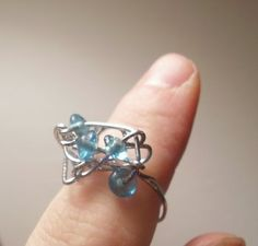How very clever.. She made this ring in less then 10 minutes out of paper clip and beads :)) So pretty too!