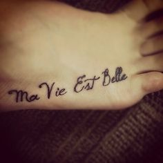 My life is beautiful in French....maybe do it in english with watercolor tattoo behind it....???