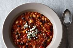 Stir in the diced tomatoes, tomato sauce, and vegetable broth. Bring to a boil then reduce to a simmer cook for 15 minutes. Add in black bea...