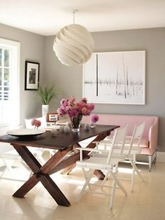 I love the balance of the colours in this room, from the taupe grey walls, light pink sofa and the white feature lamp and chairs and the warmth of th timber table.