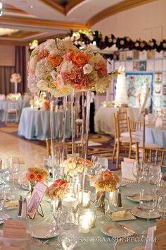 Using orange roses in both the low and high floral arrangements is a beautiful choice for a romantic tablescape.