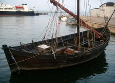 """Aluett, replica of a medieval freighter type """"byrding"""". Home port: Kalmar, Sweden. Launched: May 1995. Height: 11.6 meters. Width: 4.6 meters. Draught: 1.1 meters. Weight Ballast: 7 tons. Total weight: 11 tons. Rudder: Stern Rudder. Rowing Seats: 4. Mast height: 11 meters. Sails: One square sail on 42kvm. Engine: No. Wood: Oak and pine. Crew: 4-6 depending on skills and weather."""