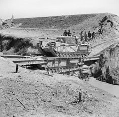 A Churchill tank of the North Irish Horse crossing the Senio in Italy on two stacked Churchill ARKs, Italy April 1945