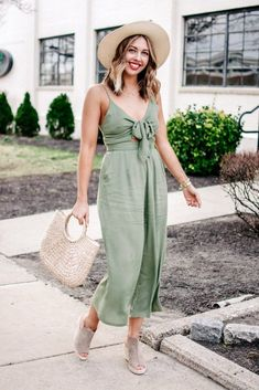 The cutest green jumpsuit that's perfect for spring or summer. A boater hat, straw handbag and espadrilles make it a perfect summer outfit but you can toss a jean jacket and a simple bag on for a spring outfit instead.