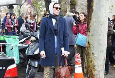 """Caption This. """"Just another day in the neighborhood with my three C's Cigarette, Coat and Cameras."""""""
