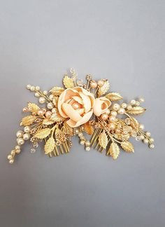 This beautiful airy handmade bridal hair comb made with pretty crystal elements, peach handcrafted flowers, ivory and peach glass pearls and tiny gold leaves. Complement most wedding hairstyles. It is the perfect bridal headpiece for that woman who wants to simply sparkle on her wedding